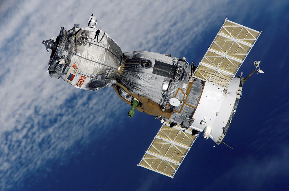 A Satellite Orbiting the Earth in a Circular/Elliptical Motion