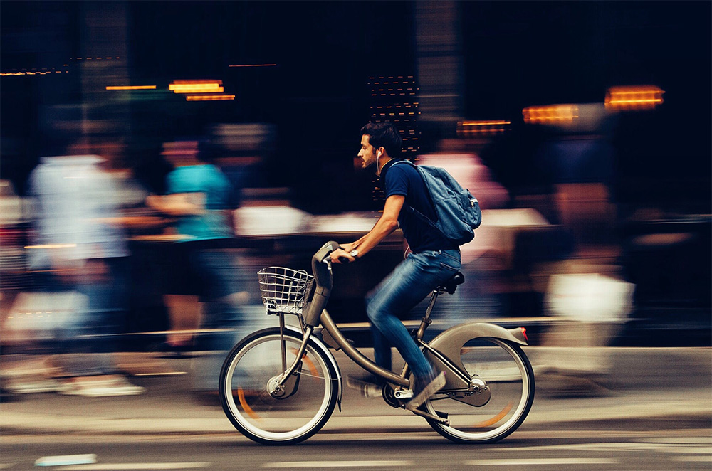 A Bicycle in Motion Exhibiting a Sum of Kinetic and Potential Energy